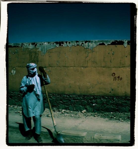 Masked Man with Shovel. 2012. Digital media.